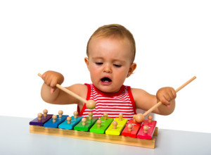 baby playing xylophone